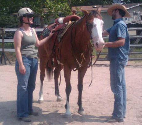 Jacob and Melissa getting Riva ready to ride.